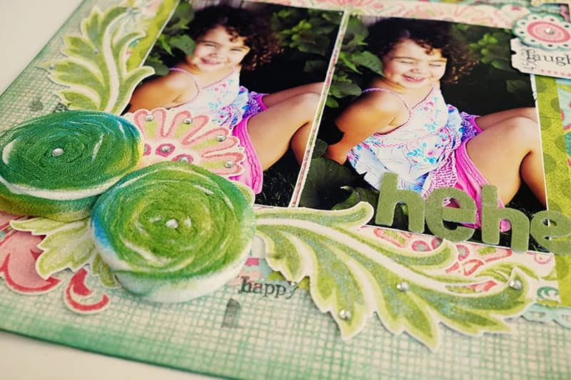 Embellishments on bottom of die cut scrapbook page