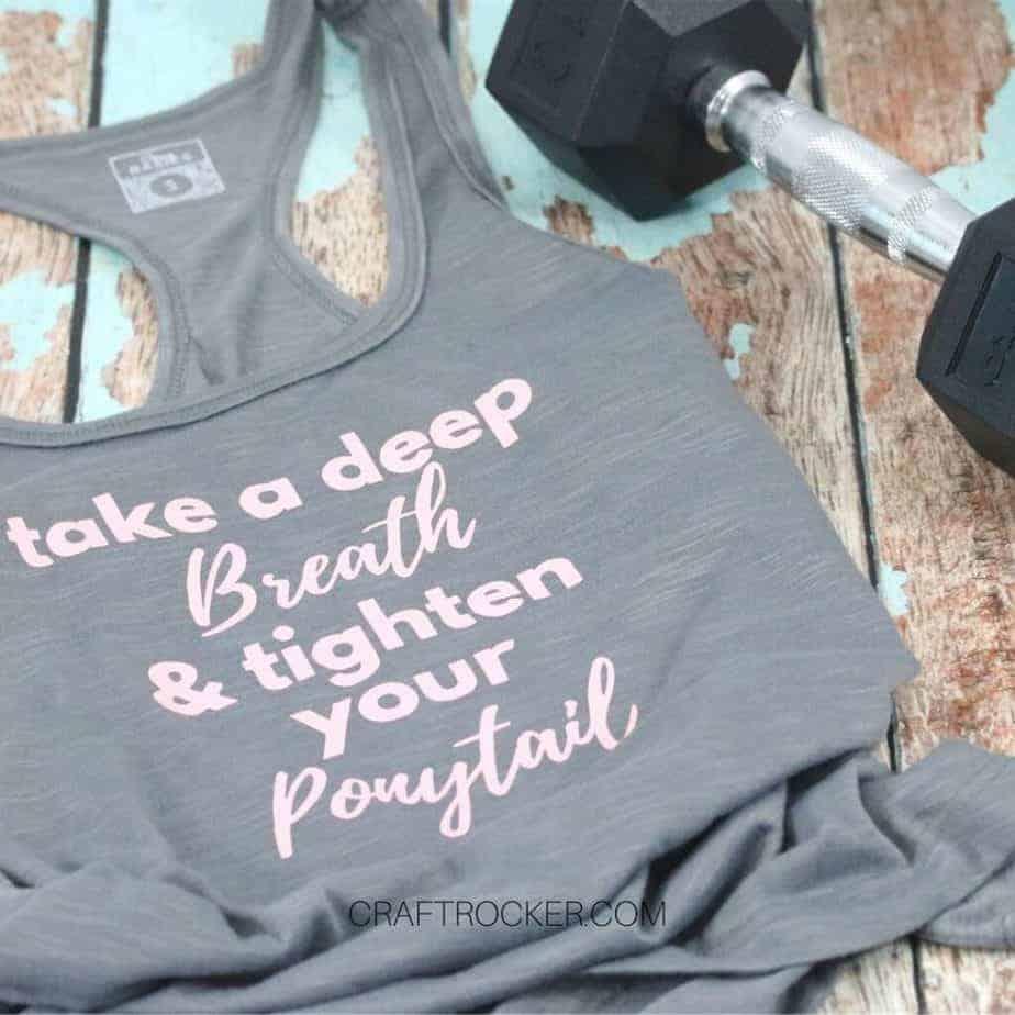 Motivational-Workout-Tank-Top-next-to-Barbell-Craft-Rocker-1024x1024