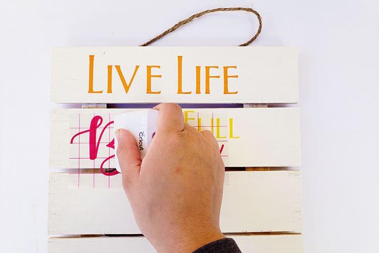 Applying-Adhesive-vinyl-to-Wood-Sign