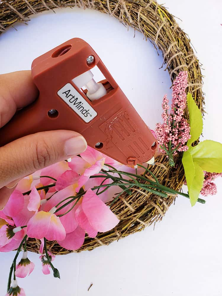 Gluing-flowers-to-Easter-wreath